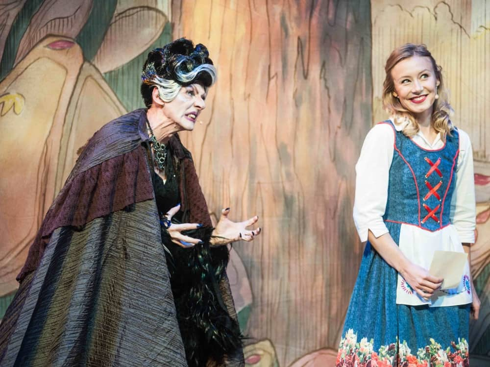 Haggard old woman played by a man tricks the beautiful blonde Belle in Beauty and the beast Newbury