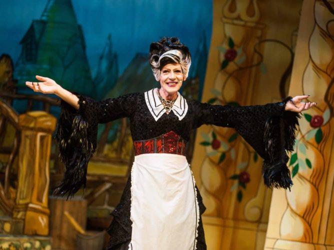 Cross dressing panto dame The Enchantress in Corn Exchnage Newbury's Christmas show Beauty and the Beast