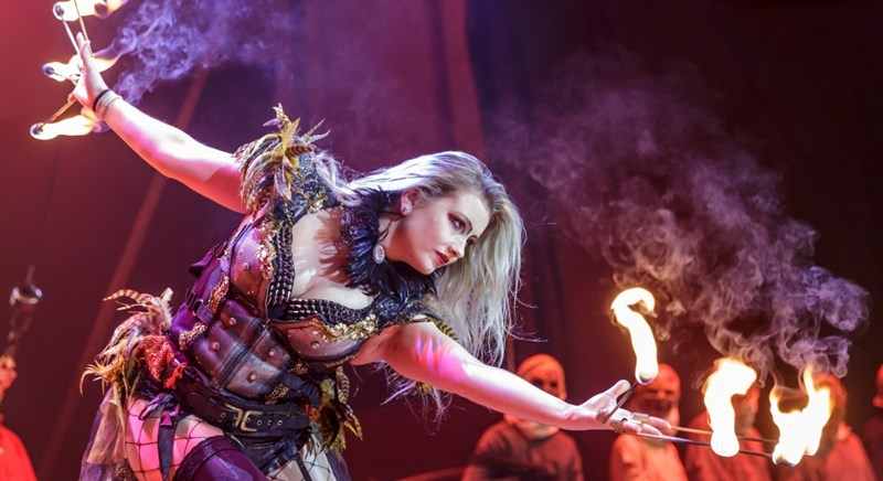 Stunning blonde playing with fire during the shocking Circus of Horrors act