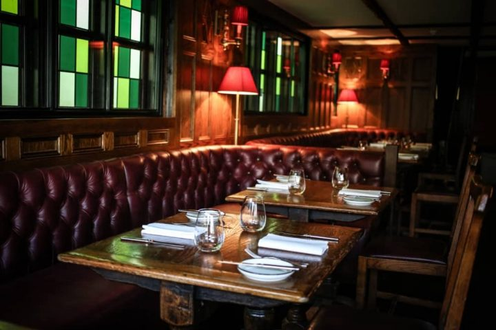 Hinds Head Bray Heston Blumenthal red leather banquette stained glass and wooden tables
