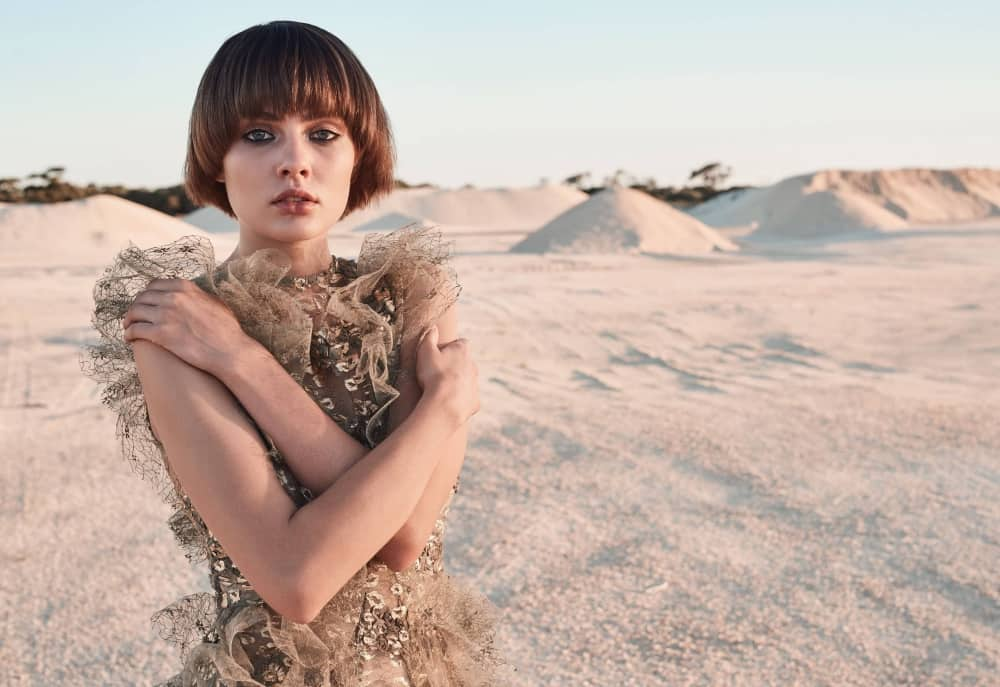 Short haired model wearing an sequin and tulle gown in the outback – Kevin Murphy