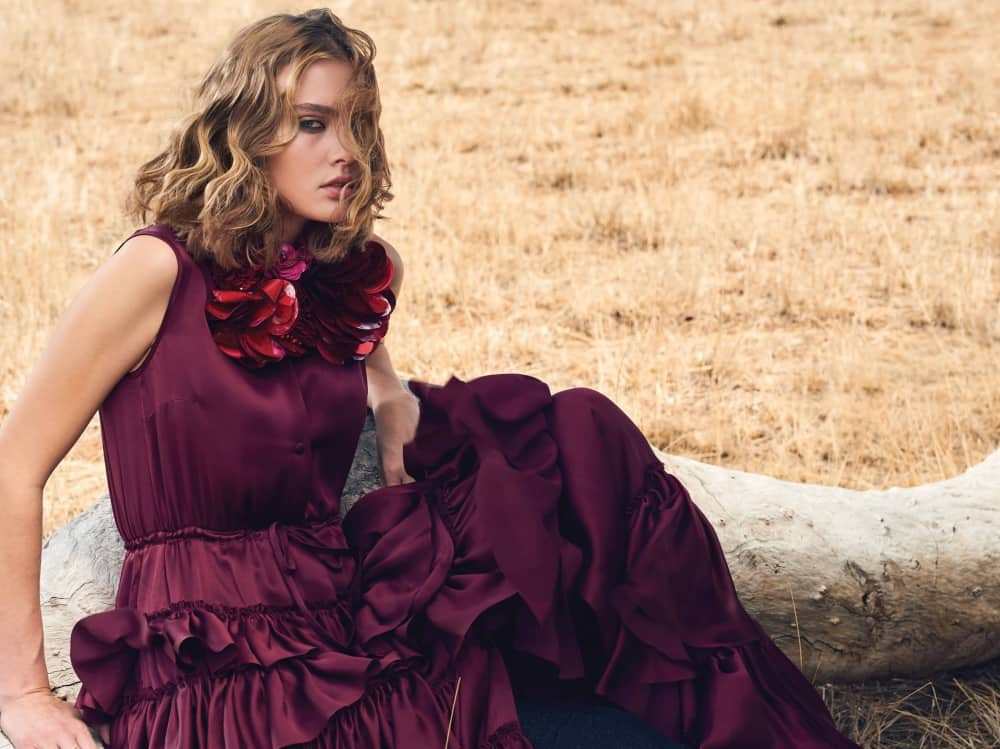 Blonde haired model with mid length curly hair wearing a burgundy silk satin evening gown in the outback – Kevin Murphy