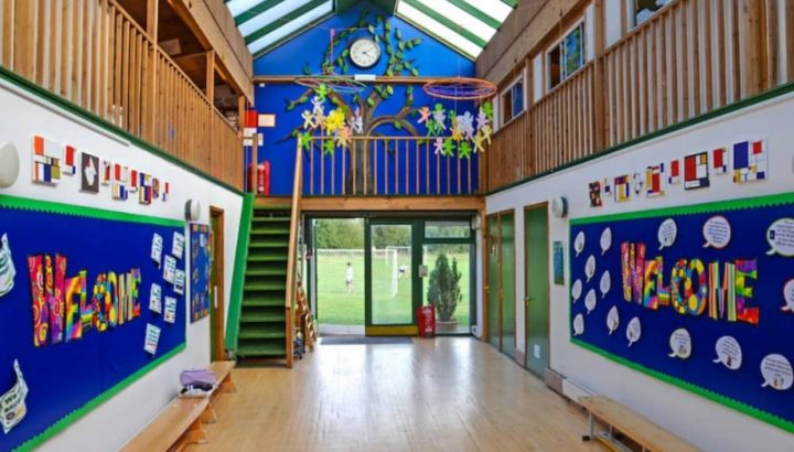 Colourful artwork and light flood into the glass atrium at Meadowbrook Montessori School in Warfield, Berkshire