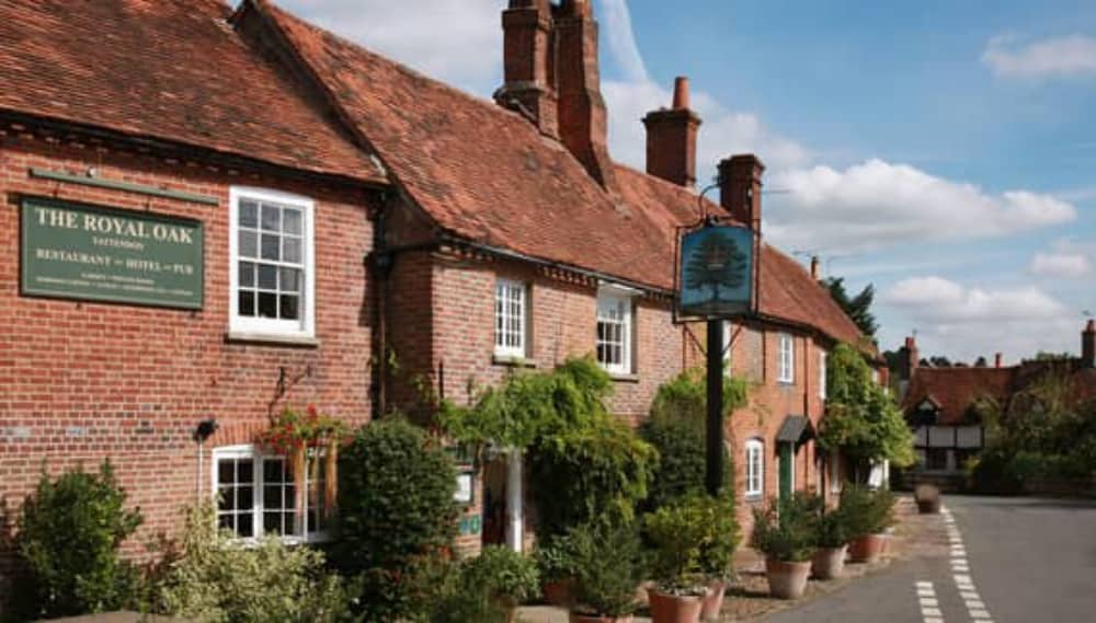 Red brick exterior of the historic country pub and hotel – Royal Oak Yattendon West Berkshire