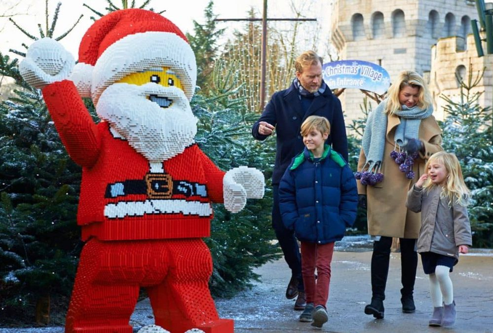 Lego Father Christmas welcomes a family to Legoland Windsor