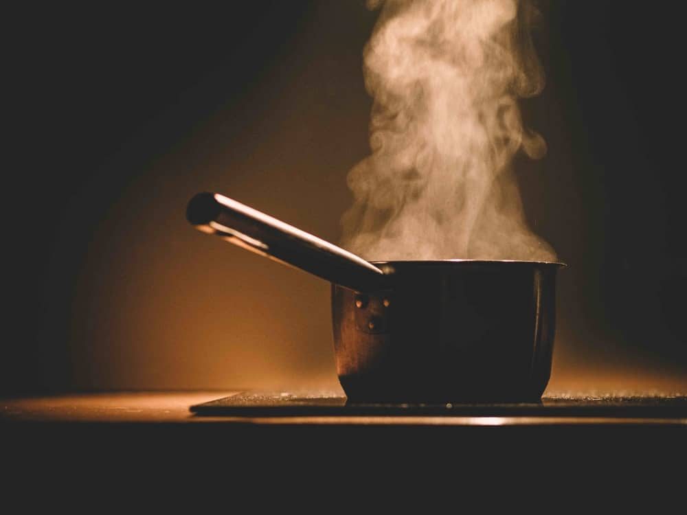 steam rising out of saucepan on hob