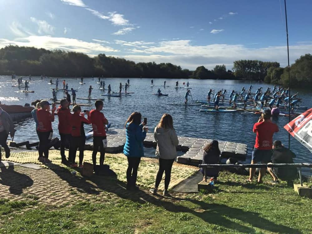 Loads of paddle boarders take to the water on a sunny day at Bray Lake in Berkshire