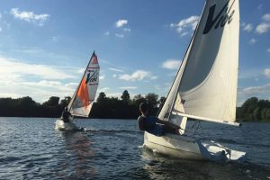 Two sailing boats take to the water at Bray Lake Watersports in Berkshire