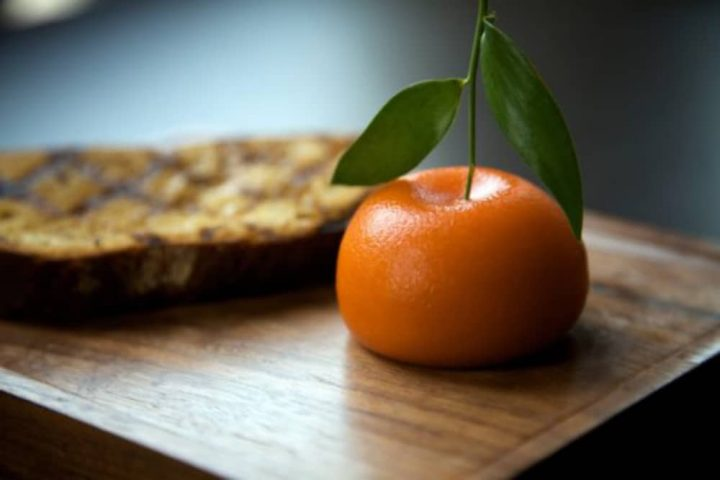 Heston Blumenthal famous MeatFruit Dish this restaurant Dinner toasted bread on a wooden board