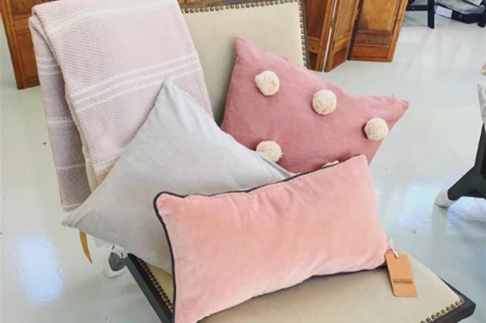 Eco-luxe interiors shop Reading Field and Hawken – baby pink cushions, antique oak screen and studded chair