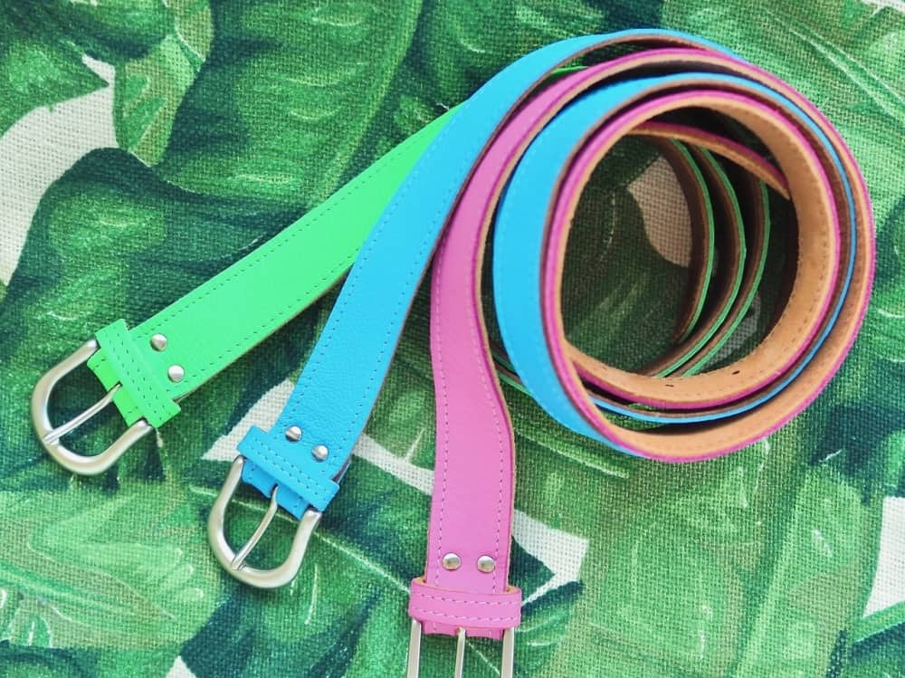 pink blue green belts on plan background gift pop