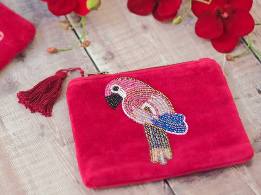 Bright pink velvet GiftPop purse with beaded parrot with hassle