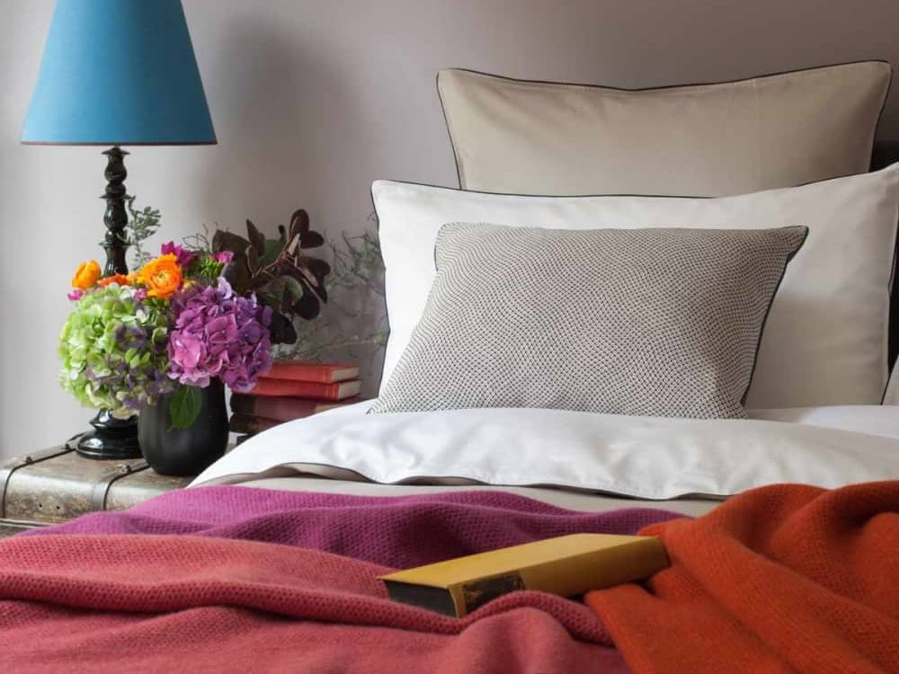 Autumnal styling in a modern luxury bedroom with an eclectic blend of pinks, orange and turquoise by Josephine Home