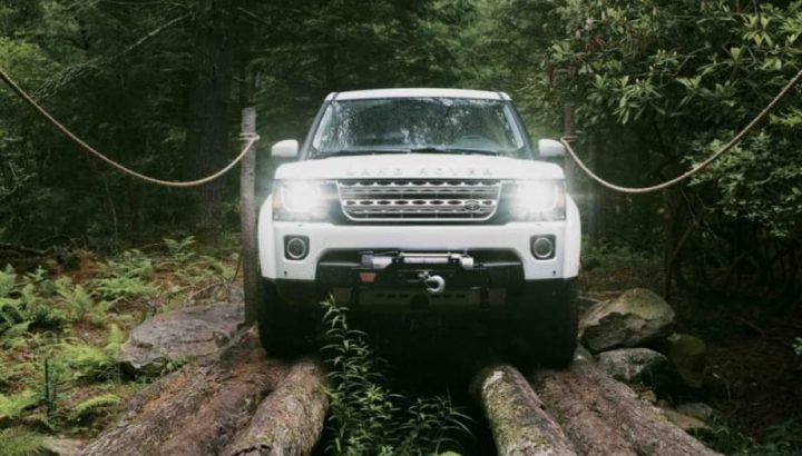 Land Rover Off Road Experience Day – Range Rover drives across logs. Muddy Stilettos competition