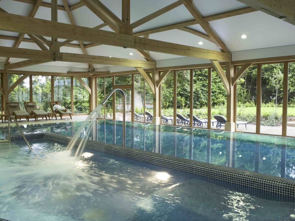 Luxury spa poo at Luton Hoo Hotel, Golf and Spa with beamed ceiling and glass walls