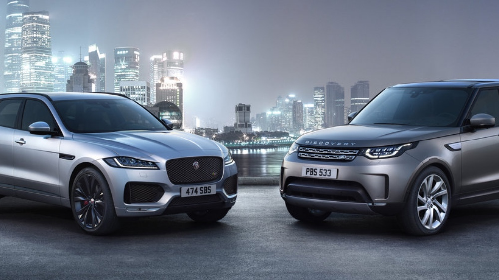 Jaguar and Land Rover cars with city background