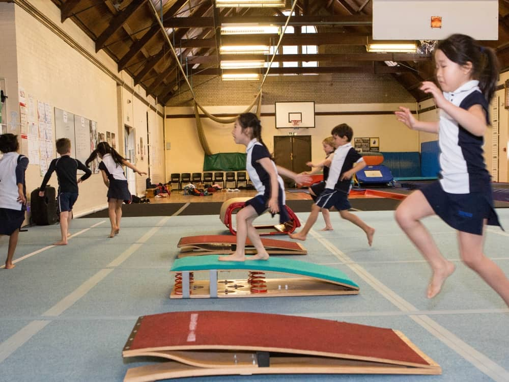 Kids jump to it on the springboard i the new state of the art gymnasium centre at Reddam House School Berkshire