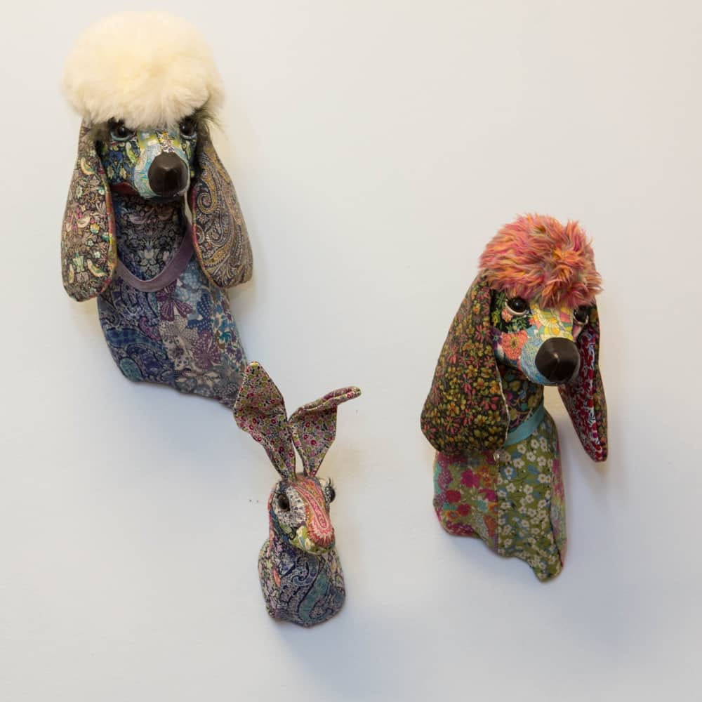 Liberty print poodle and hare heads on the wall of Reddam House Berkshire School