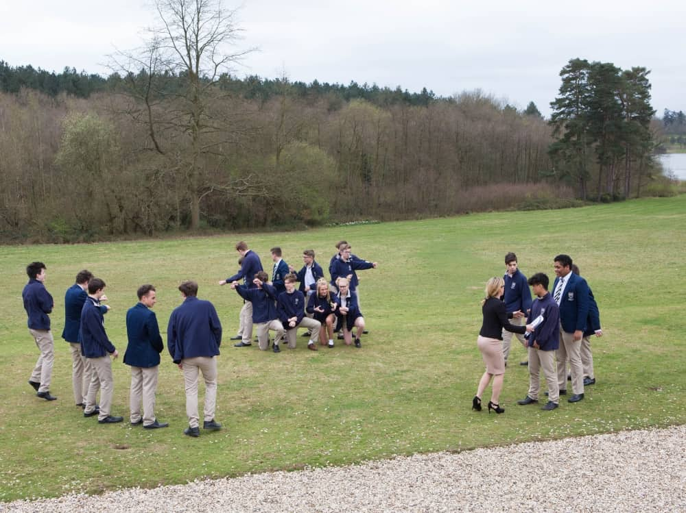 Wearing navy and khaki multi uniform worn by students at Reddam House Berkshire School