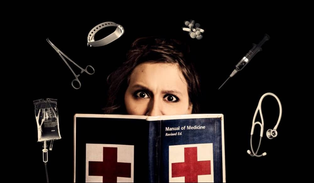 Comedian Helen with medical manual surrounded by medical instruments