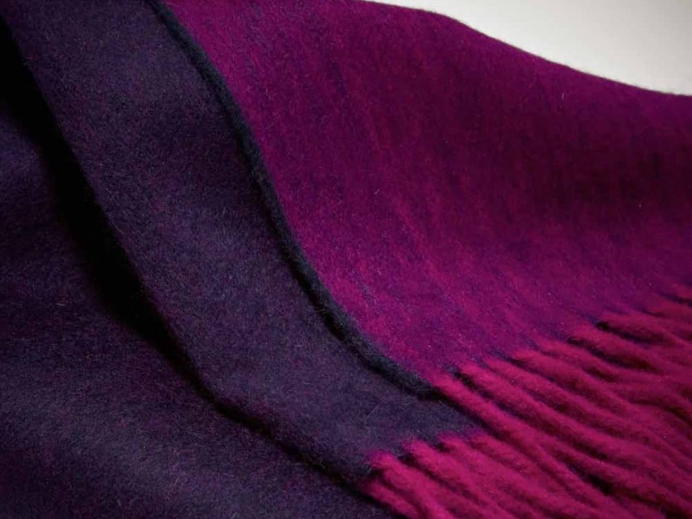 Raspberry and purple reversible wool throw by Josephine Home