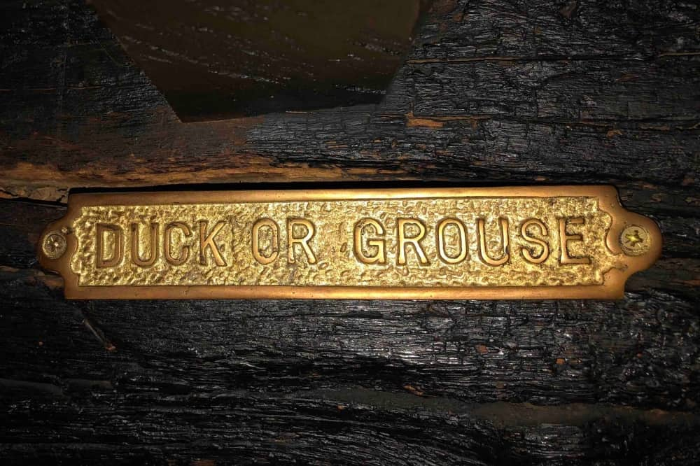 Duck or grouse brass sign on beam Crown Bray Heston Blumenthal