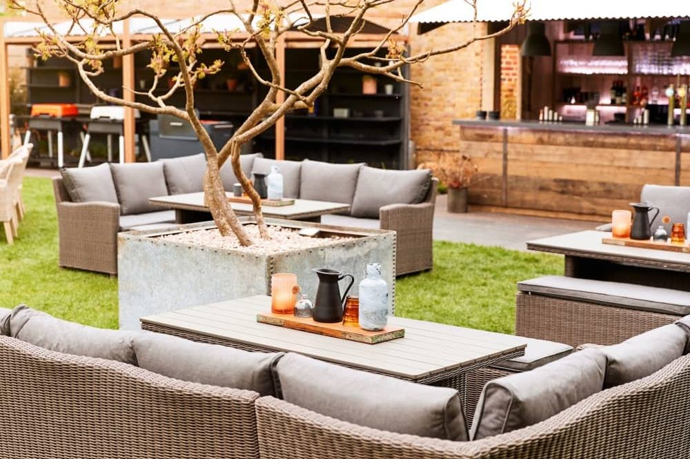 The Crown at Bray Berkshire Heston pub garden with sofas cushions decorative tree and