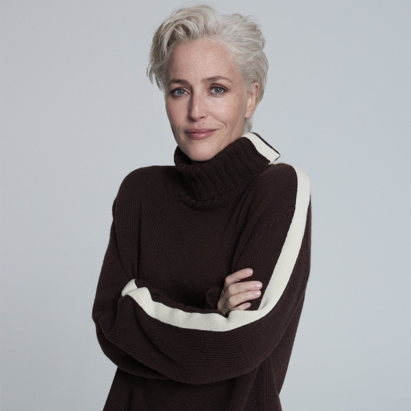 Gillian Anderson actress wearing chocolate brown with white arm stripe roll neck jumper short platinum blonde quaffed hair Winter London collaboration