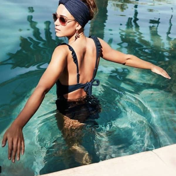 Holiday capsule Wardrobe Accessorise navy blue swimsuit scallop edging and headband turban in pool