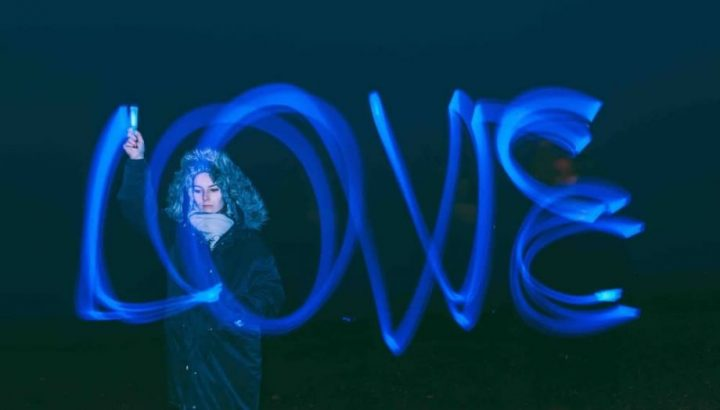 Laser LOVE woman spells out love with laser pen