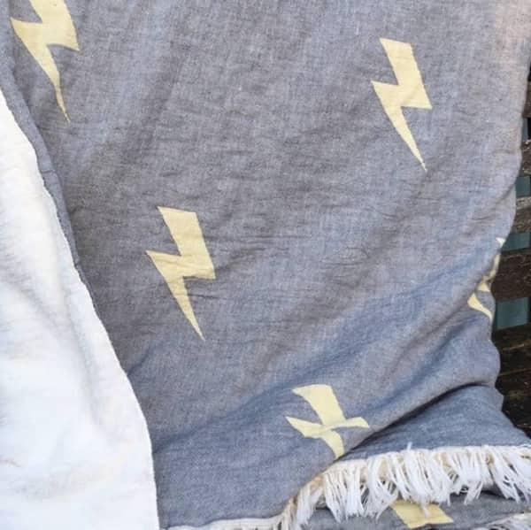 Grey cotton and lightening throw with fleece back