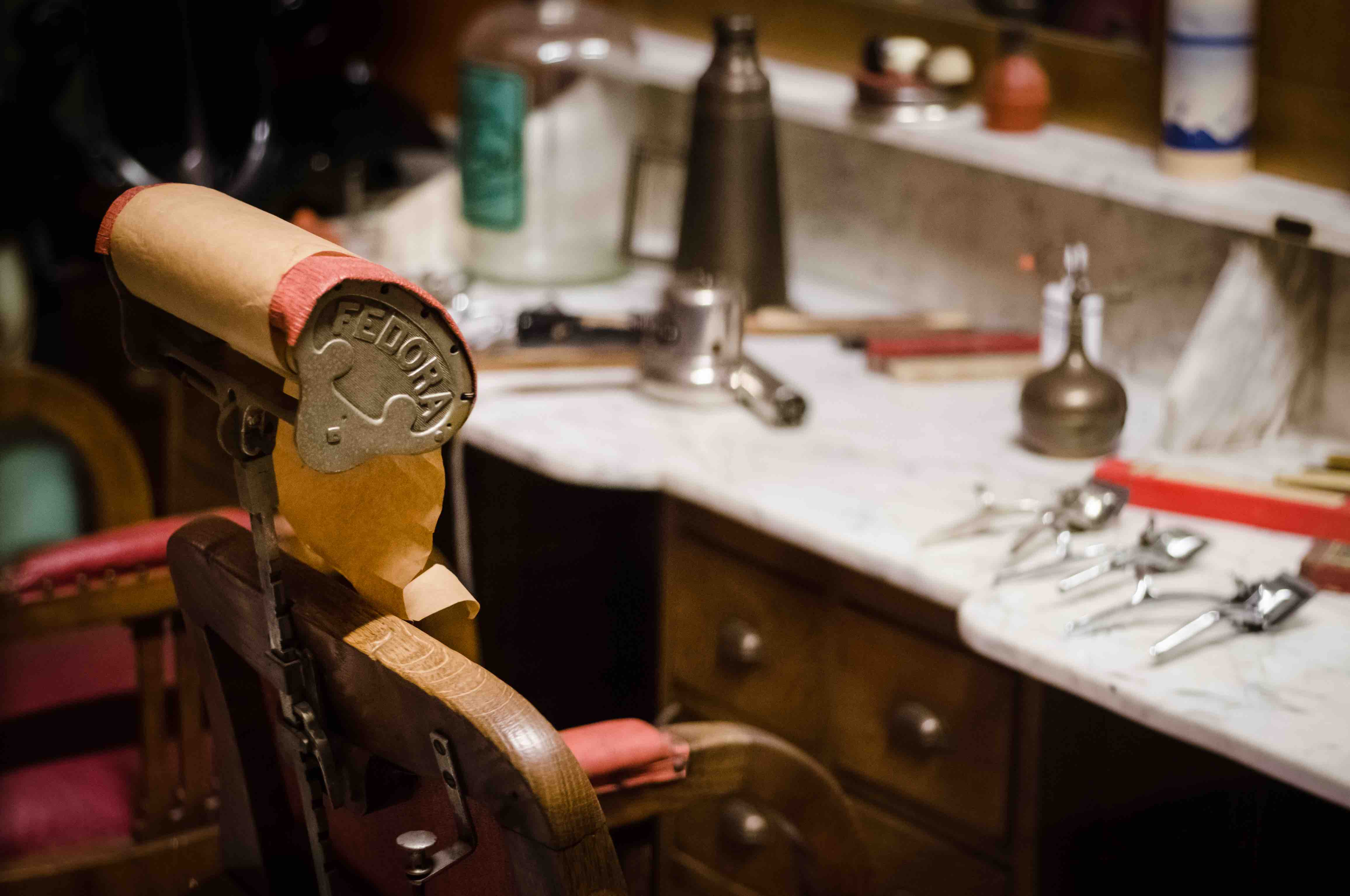vintage barbers chair, razors and brushes