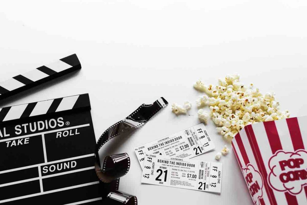 Film making Clapper board popcorn and cinema tickets
