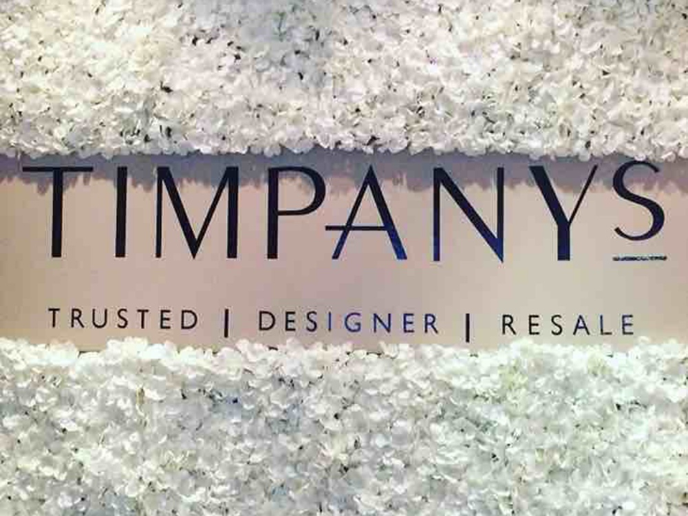 Timpmays logo and floral dimply at new Sunningdale store