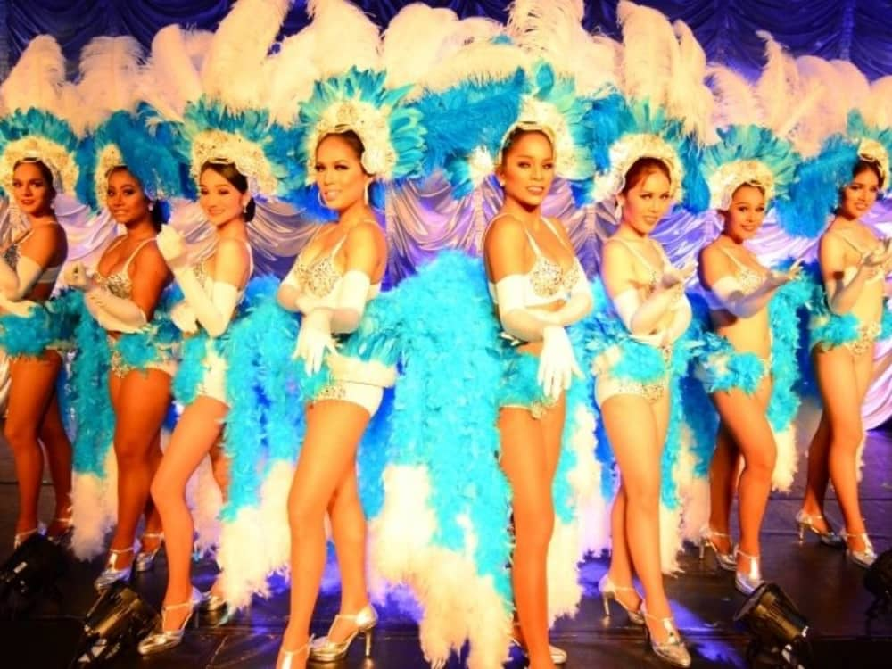 Ladyboys of Bangkok in feathers and sequins in their hit show wonder woman