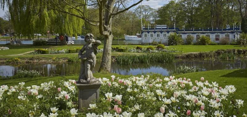Stunning riverside location of the Swan at Streatley boutique hotel Berkshire with historic steamer boat