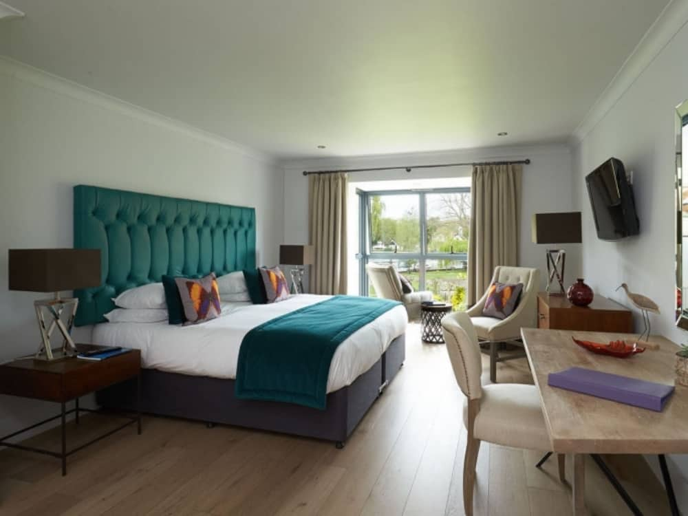 The Swan at Streatley riverside boutique hotel berkshire modern bedrooms with teal button back headboard
