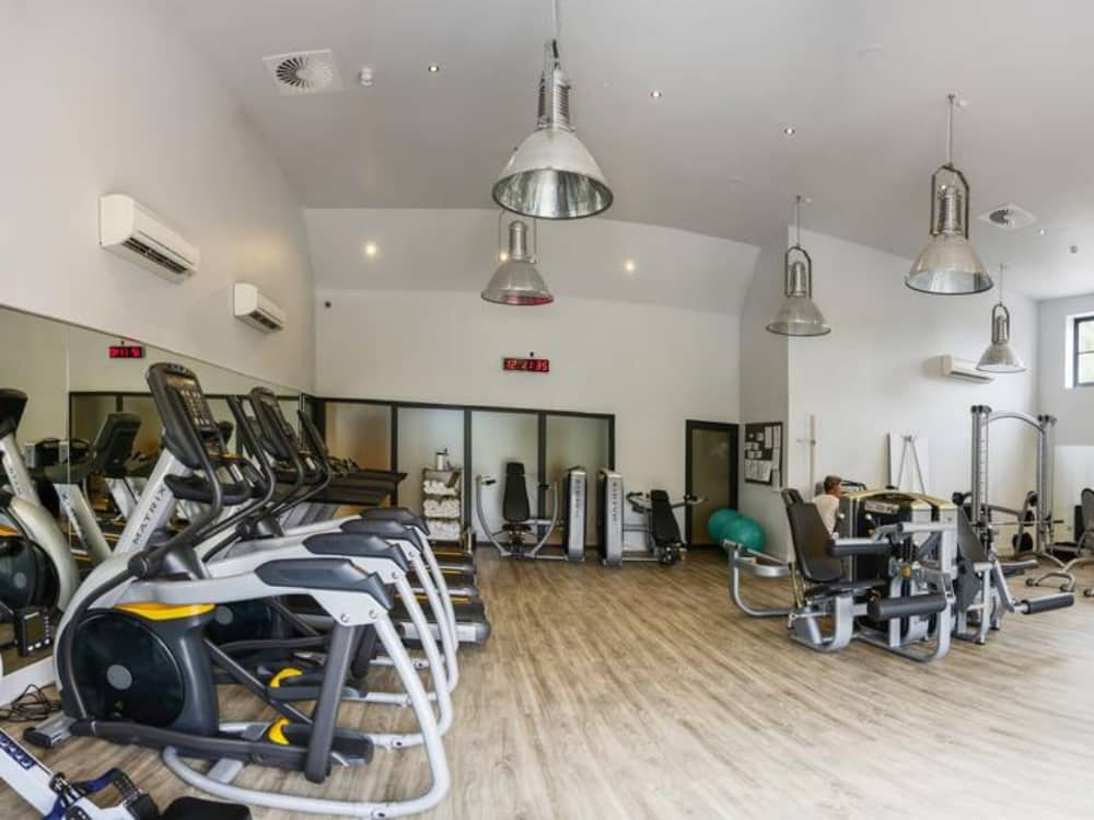 Large modern gym Swan At Streatley Berkshire river views state of the art equipment industrial lighting