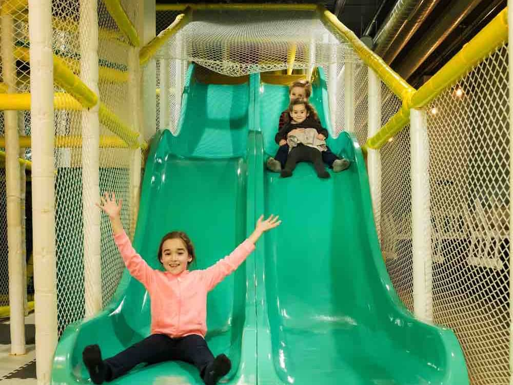 green wavy slide at posh play kids activity centre The jelly Lounge Windsor Berkshire