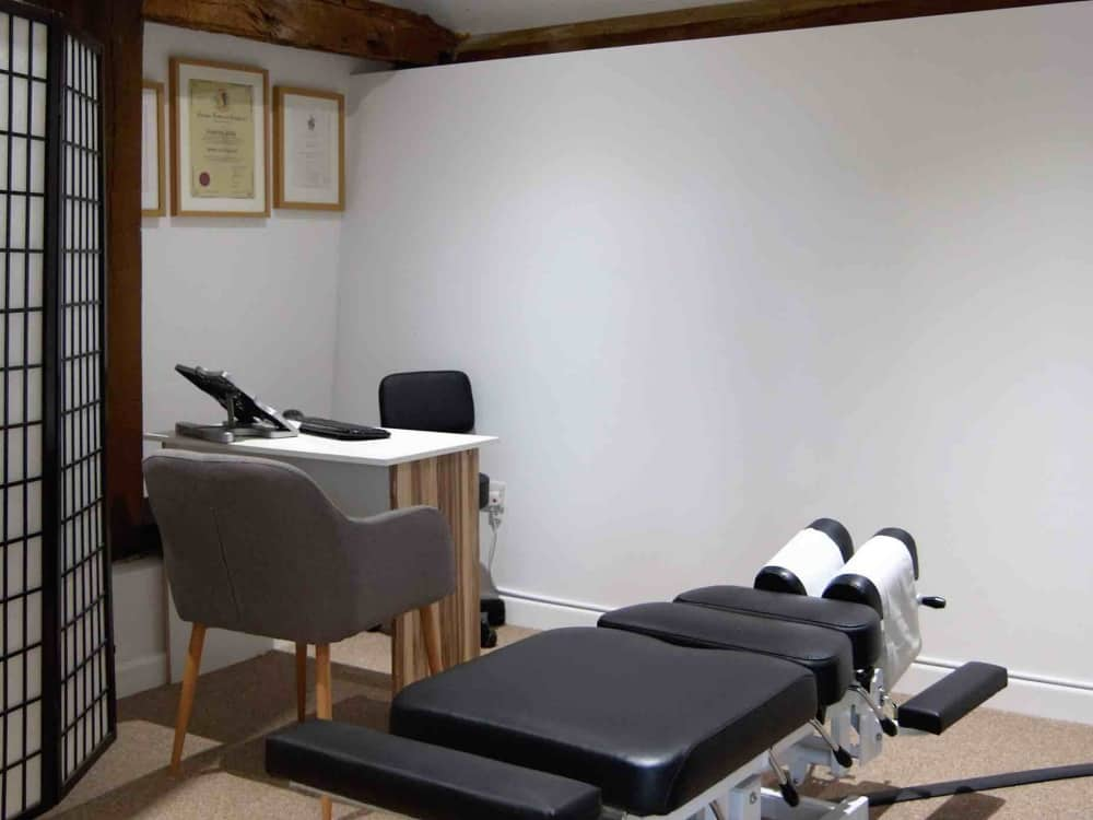 Stylish treatment room with chiropractic bed at Total Health West Berkshire