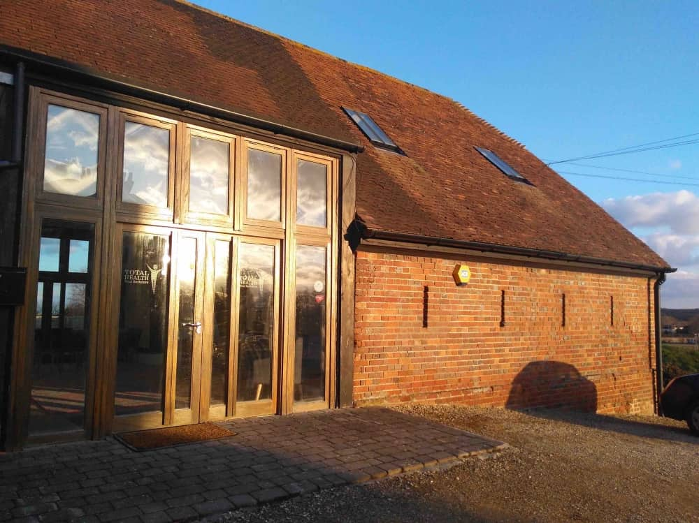 Grade 2 listed red brick barn Total Health West Berkshire complementary health clinic