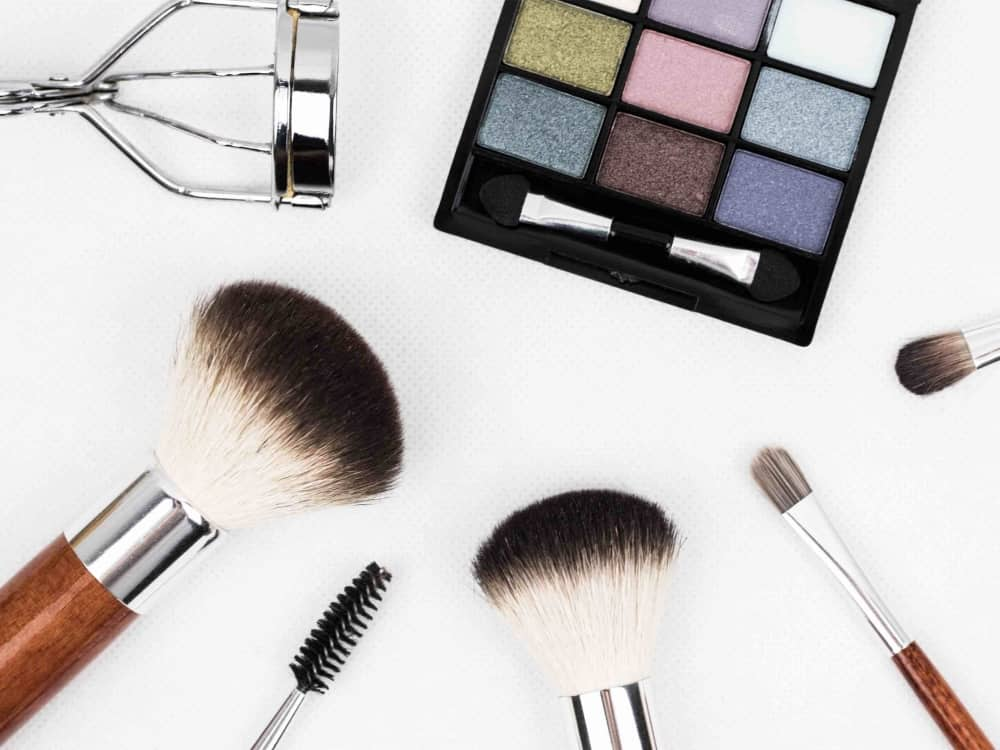 beauty products, make up brushes and eyelash curlers