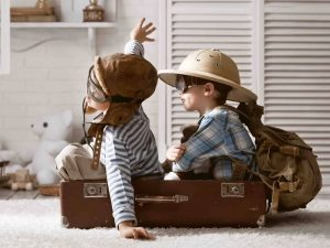 children old suitcase make believe flying off on adventures