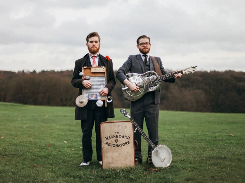 The Washboard Resonators folk band banjo field suits