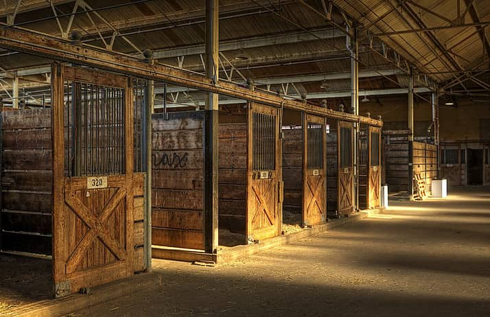 Empty horse stables in a barn wood and steel