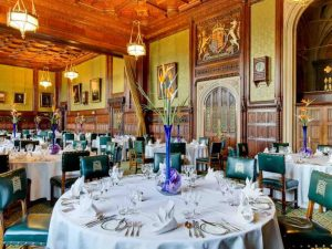 Corporate lunch organised at the House of Commons with its traditional green chairs and wood panelling with modern centrepieces