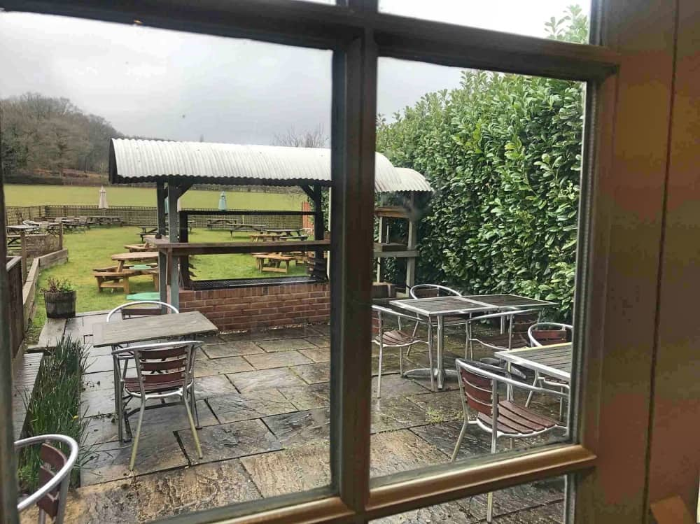 view through window patio large grill and lawned beer garden Bunk Inn Curridge Berkshire