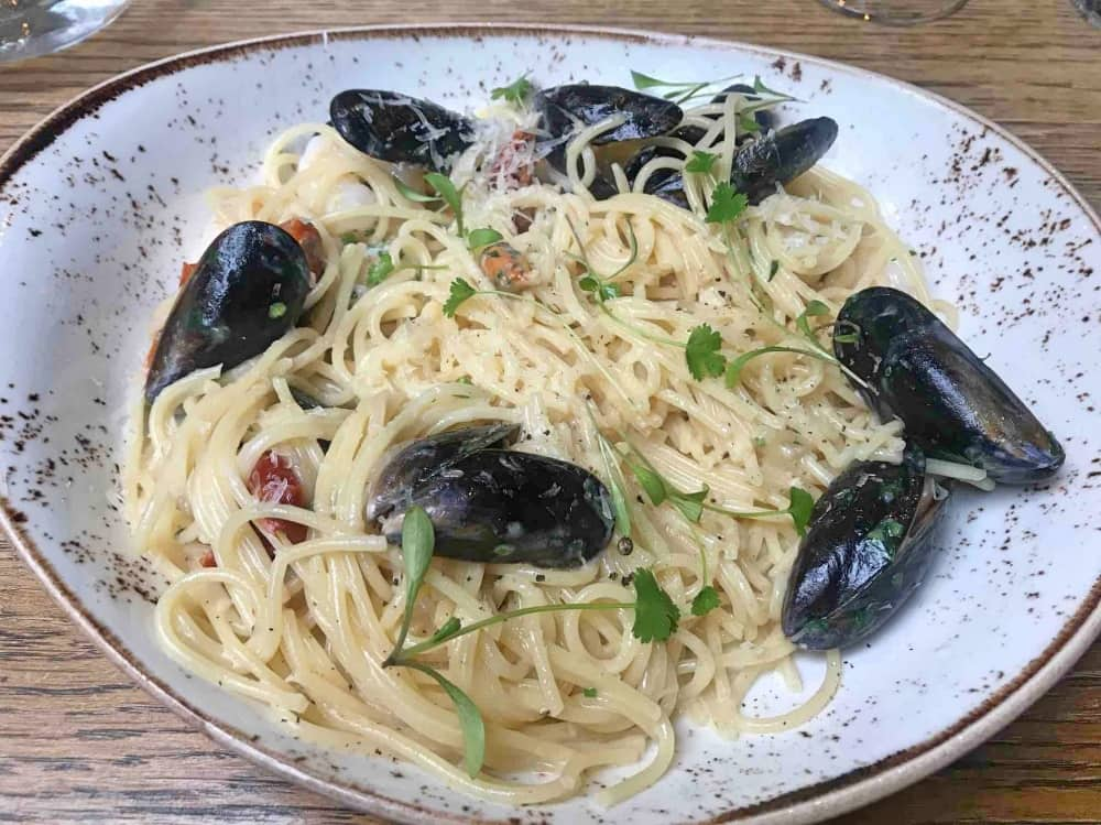 Mussel and prawn linguine on a speckled handmade plate Bunk Inn Curridge Berkshire