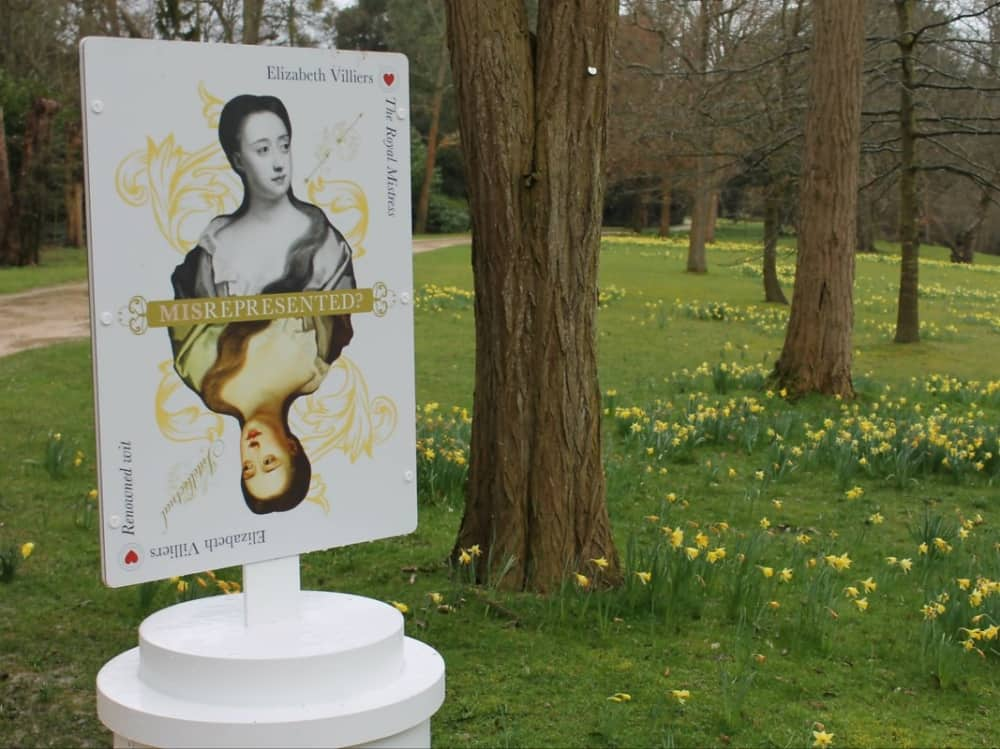 Cliveden National Trust Misrepresented exhibition The Royal Mistress Elizabeth Villiers sits in a field of daffodils