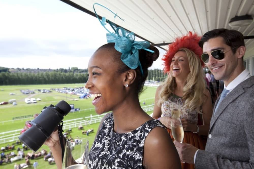 Ladies Day Newbury Racecourse won in glam dresses and hats